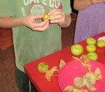 Kids-Peeling-Tomatillos