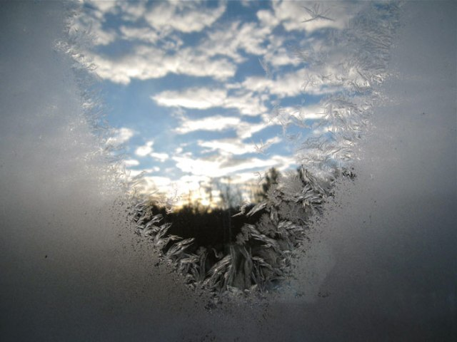 Ice crystals still form on the windows, blocking the view of the sunrise.