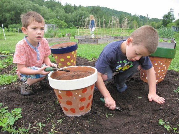 Garden camp was good because we played in the sprinkler.  We got to dig and weed.  I liked planting. Liam, age 5