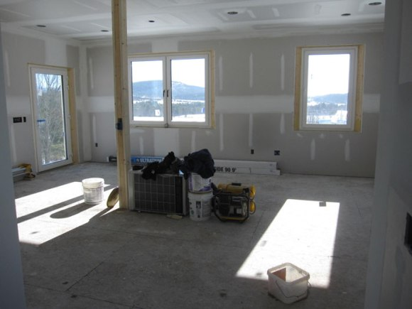 Looking south - check out those views and that sun!  Our dining room table will sit near the double windows.