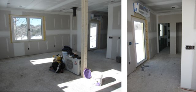 Looking to the west, our living room area, with our front door and bathroom down the hall.