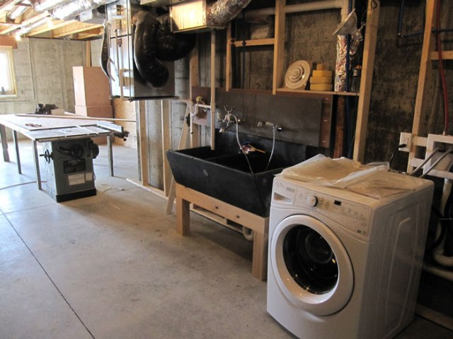 Sunny basement with a functional washing machine and the soapstone sink from Debbie's Brookline basement.