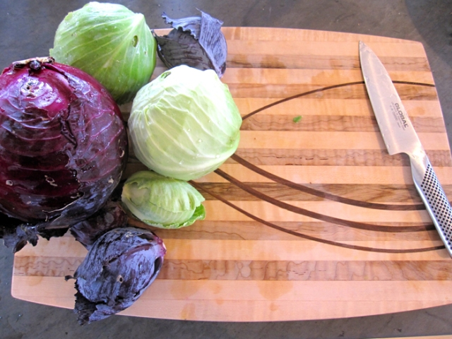 Ready to chop cabbage on a beautiful cutting board made by a friend